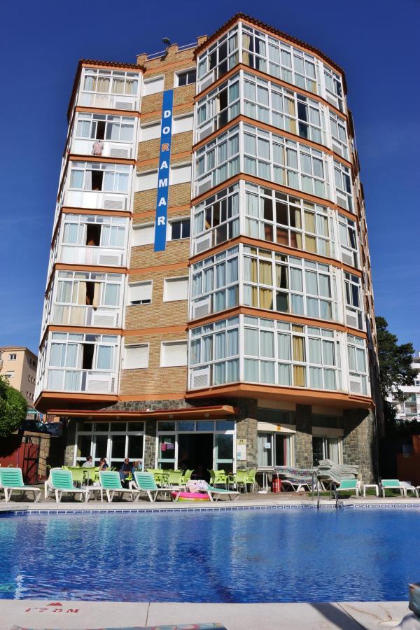 Vista desde la piscina - Apartamentos Doramar